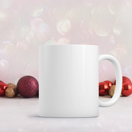 White blank coffee mug Christmas theme mock up to add custom design or quote. Perfect for businesses selling mugs, just overlay your quote or design on to the image. Stock Photo