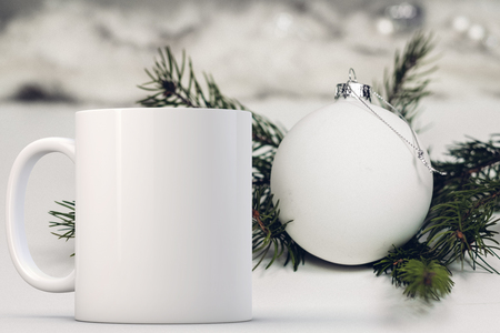 White blank coffee mug Christmas theme mock up. Perfect for businesses selling mugs, just overlay your quote or design on to the image.
