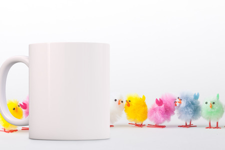 White Mug Mockup - Easter theme. Perfect for businesses selling mugs, just overlay your quote or design on to the image.  Stock Photo