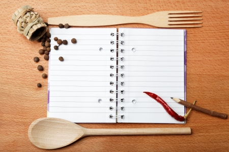notebook for recipes and spices on wooden table Stock Photo