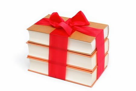 A stack of books on a white background  Фото со стока