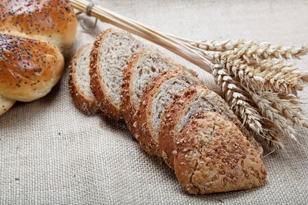 Fresh bread with ears of wheat on the canvas. Stock Photo - 14791217