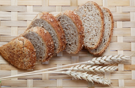 Fresh bread with ears of wheat Stock Photo