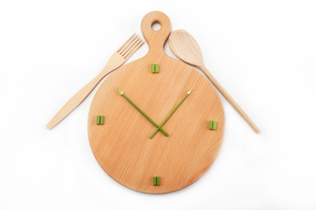 Lunch time. Cutting board with sliced green onions laid out as a clock. photo