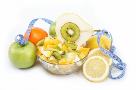 Fresh fruits and salad isolated on a white background. photo