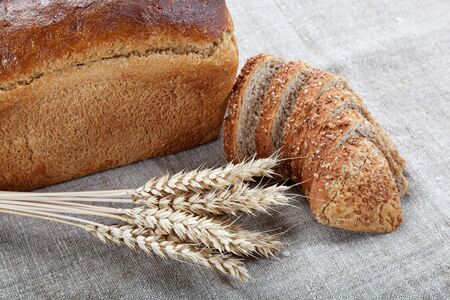 Fresh bread with ears of wheat on the canvas. Stock Photo - 14860634