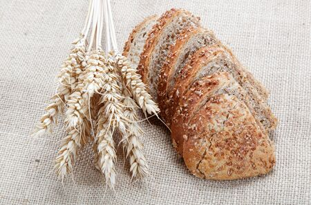 Fresh bread with ears of wheat on the canvas. Stock Photo - 14861483