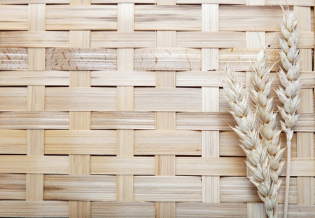 ears spike of wheat on wood texture background photo