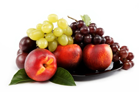 Fruits nectarine and a bunch of grapes isolated against white background. photo