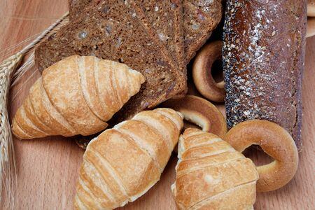 Assortment of baked goods in wood background photo