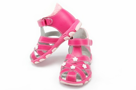 teen girls feet: pink childs sandals isolated on white