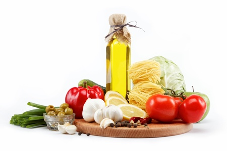 set fresh vegetables with olive oil isolated on white background photo