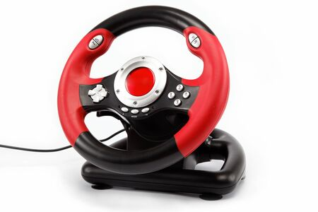 Computer game consoles, steering wheel, isolated on white. photo