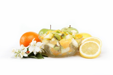 Fresh fruits and salad isolated on a white background. Stock Photo - 14859649