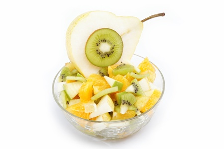 Fresh fruits salad on white background photo