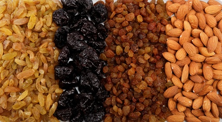 Mixed nuts and dried fruits. Almonds, raisins and prunes. photo