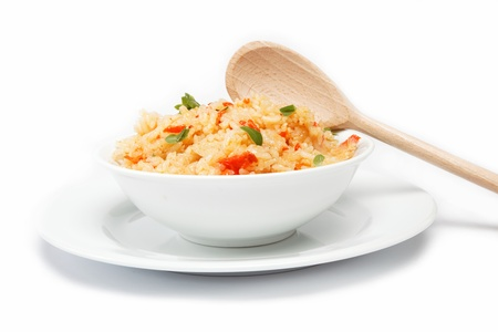 Rice in a bowl on a white background.