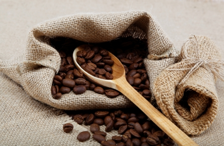 Coffee beans in a bag on sacking. photo