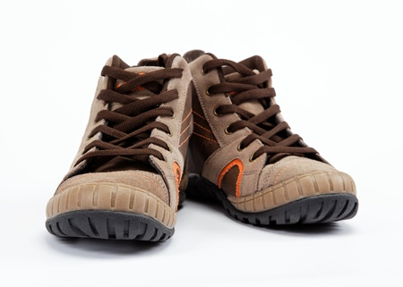 A pair of new hiking boots on white background Stock Photo - 15022323