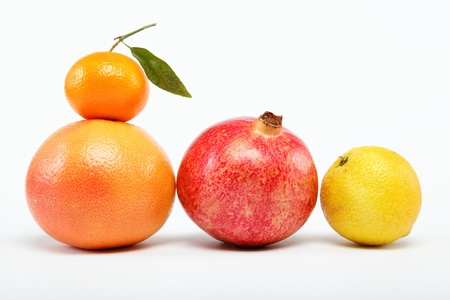 pomegranates and citrus fruits isolated on a white background. Stock Photo - 15022449