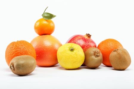pomegranates and citrus fruits isolated on a white background. Stock Photo - 15022467