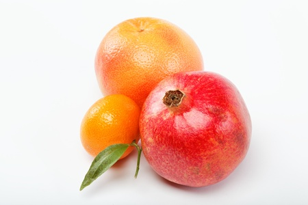 pomegranates and citrus fruits isolated on a white background. photo