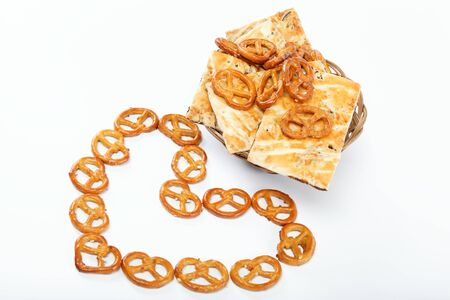 appetiser: Crispy pretzels stacked in the form of the heart.