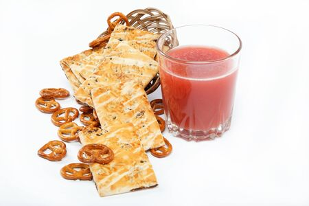 appetiser: Light lunches. Crunchy biscuits and juice on a white background.