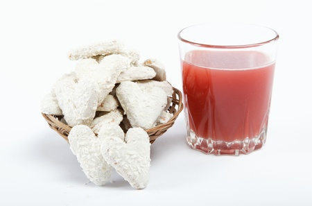 appetiser: Light lunches. Cookies and a glass of juice on a white background.