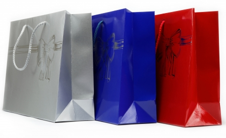 Red, blue and gray gift bags on a white background. photo