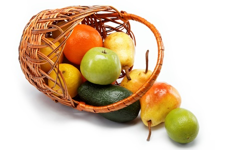 fruits in basket isolated on a white background. Stock Photo