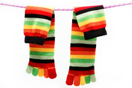 Colorful fun sock hanging on a rope. Stock Photo - 15092284