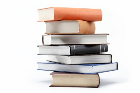 A stack of books on a white background. Standard-Bild