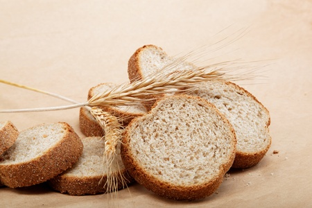 Fresh bread isolated on a light brown background. Stock Photo - 15092356