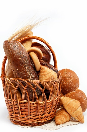 Fresh bread in the basket fully isolated.