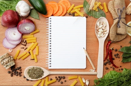 cook book: notebook for recipes and spices on wooden table Stock Photo