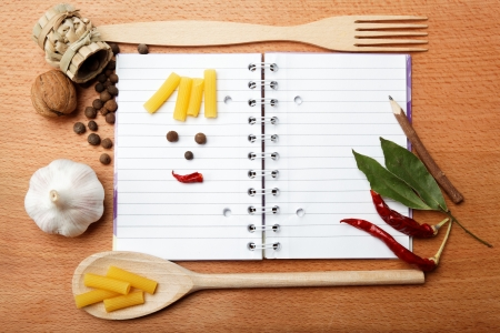 notebook for recipes and spices on wooden table Banco de Imagens