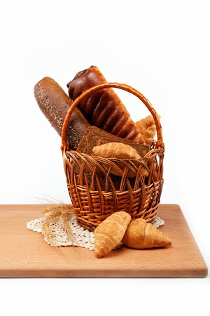 bread basket: Fresh bread in the basket isolated.