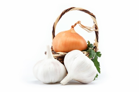 Fresh bulbs of onion in basket on a white background photo