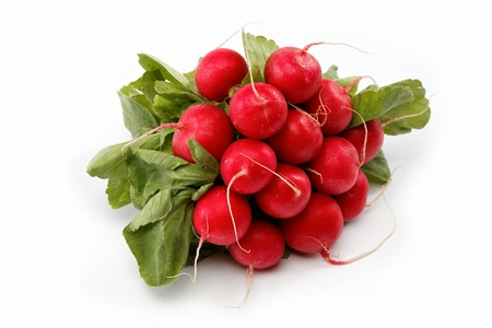 pungent: Healthy food. Bunch of fresh radishes on a white background. Stock Photo