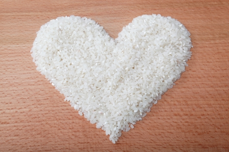 Heart of rice laid on a wooden table.