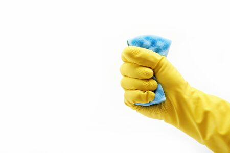 Hand with rubber glove and cleaning sponge on white background photo