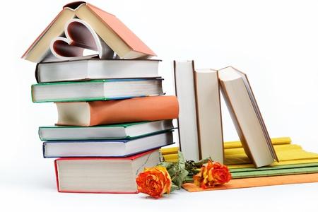 A stack of books on a white background. Фото со стока