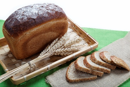 Fresh bread with ears of wheat on the canvas. Stock Photo - 15232560