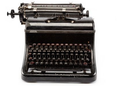 Old antique typewriter on a white background. Stock Photo - 15707525