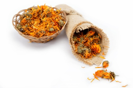 Herbs  Dried calendula or pot marigold flowers isolated on white background Stock Photo - 15797438