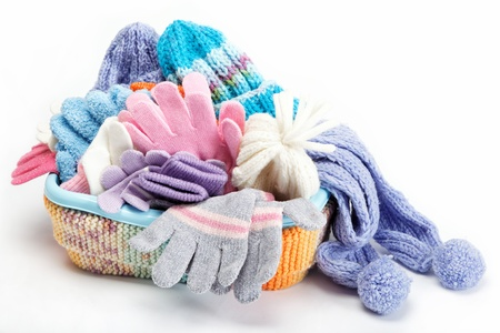 Winter accessory collection  Hat, scarf and mittens in the container, isolated on white background  Standard-Bild