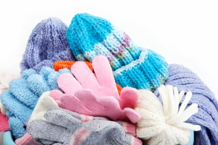 Winter accessory collection  Hat, scarf and mittens, isolated on white background  photo