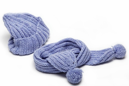 Cold winter clothing - hat or cap, scarf. Standard-Bild