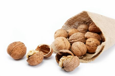 Walnut in a bag on a white background Stock Photo - 16002686